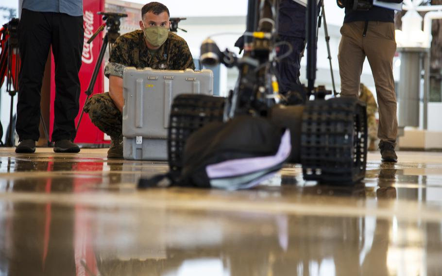 Staff. Sgt. Keith Lowe, an explosive ordance disposal technician with Marine Wing Support Squadron 171, operates a robot at Marine Corps Air Station Iwakuni, Japan, Friday, July 9, 2021.