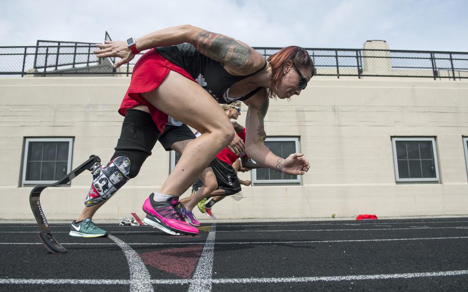 Marine Corps veteran Sarah Rudder teaches starting from blocks during track practice for the 2017 Dept. of Defense Warrior Games in Chicago, Ill. June 30, 2017. In 2016 and 2017, she won 12 gold medals for Team USA at the global Invictus Games for wounded service members. She will compete in the first-ever adaptive division at the 2021 CrossFit Games in Madison, Wis.