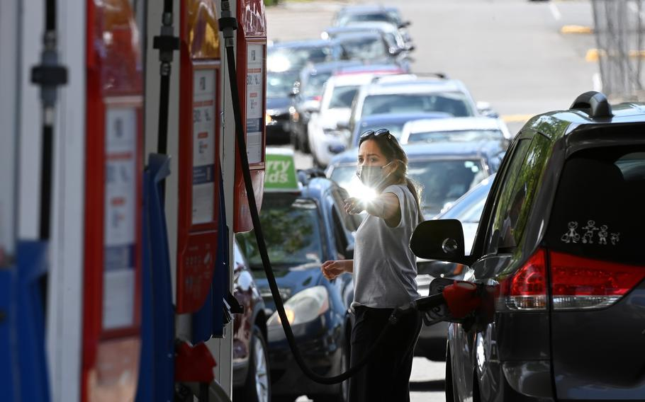 After a cyber hack of the Colonial Pipeline led to gas shortages, people waited in long lines at an Exxon station on May 12, 2021, in Springfield, Va.