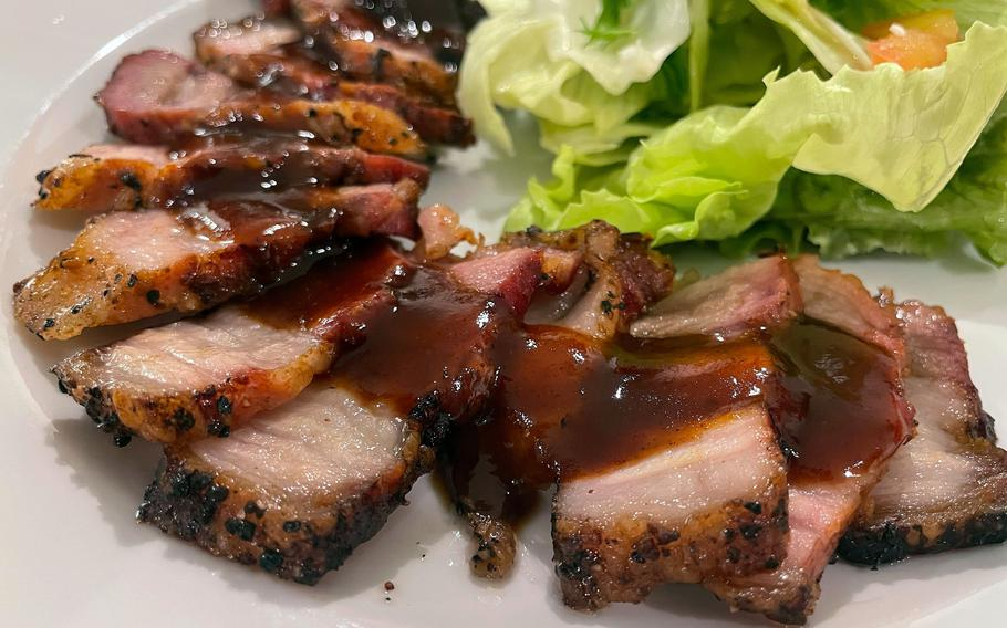 The house-smoked pork belly appetizer from Kemby's Diner in Iwakuni, Japan, was savory and delicious.