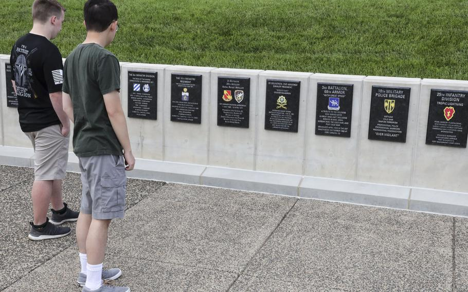 Visitors view unit tributes outside the National Museum of the United States Army on its reopening day, June 14, 2021.