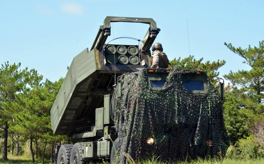 A member of 3rd Battalion, 12th Marine Regiment readies an M142 High Mobility Artillery Rocket System, or HIMARS, during the Noble Jaguar exercise at Central Training Area, Okinawa, Thursday, Sept. 30, 2021.