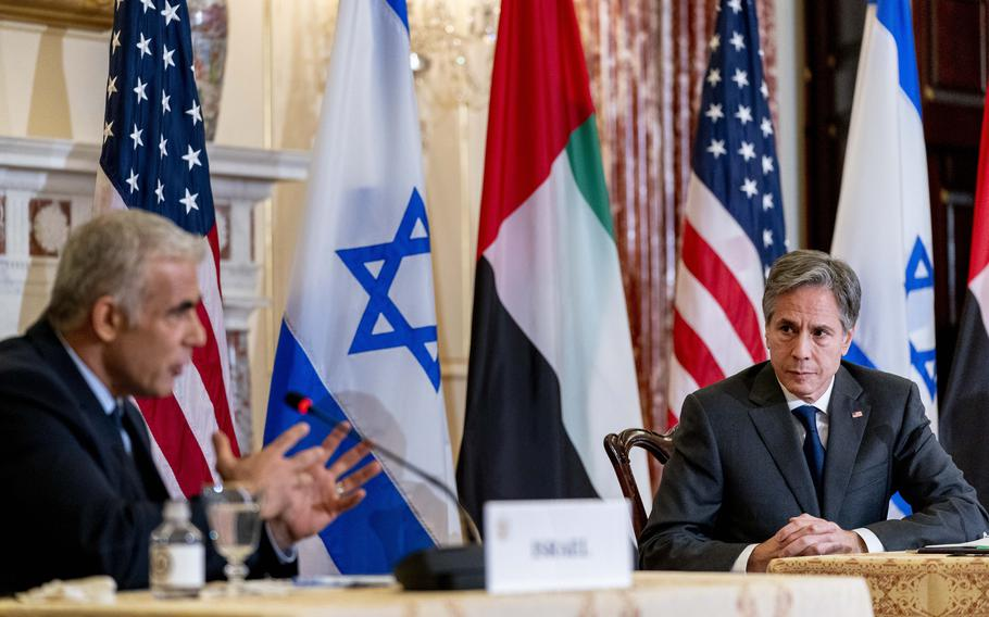Israeli Foreign Minister Yair Lapid, left, accompanied by Secretary of State Antony Blinken, right, speaks at a joint news conference at the State Department in Washington, Wednesday, Oct. 13, 2021.
