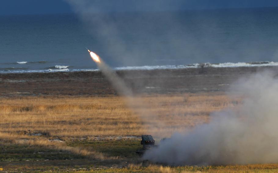 A U.S. M142 High Mobility Artillery Rocket System fires its rockets into the Black Sea during Exercise Rapid Falcon Nov. 19, 2020 at Capu Midia, Romania. This was 1st Battalion, 77th Field Artillery Regiments second live fire event since reactivation just 90 days ago and was the first time U.S. forces, in cooperation with Romanian allies, ever fired HIMARS from land into the Black Sea.   H. Marcus McGill/U.S. Army
