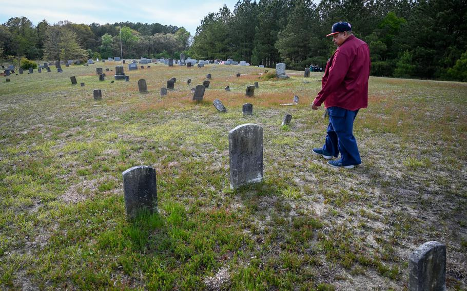 Rudolph Eugene Stanley, 72, walks through Zion Cemetery, where many of the community's founders and eight generations of its residents are buried. Stanley grew up in San Domingo and is the community's leading geneaologist.
