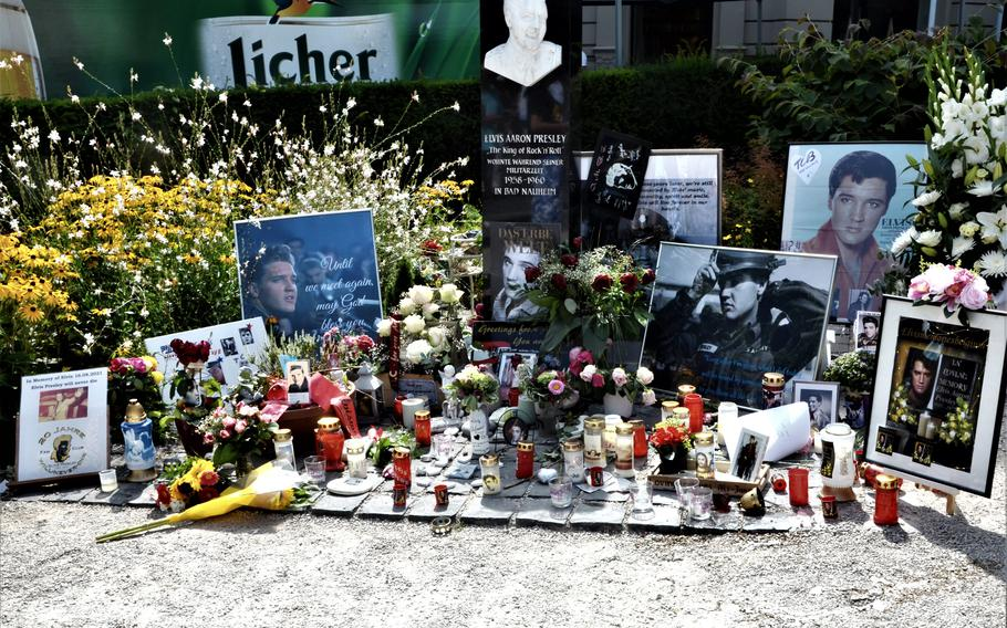 Flowers, candles and photos of Elvis Presley stand at Elvis-Presley-Platz in Bad Nauheim, Germany, Aug. 15, 2021. The town, where the American rock 'n' roll star lived from 1958-1960, holds a festival in Presley's memory in August.