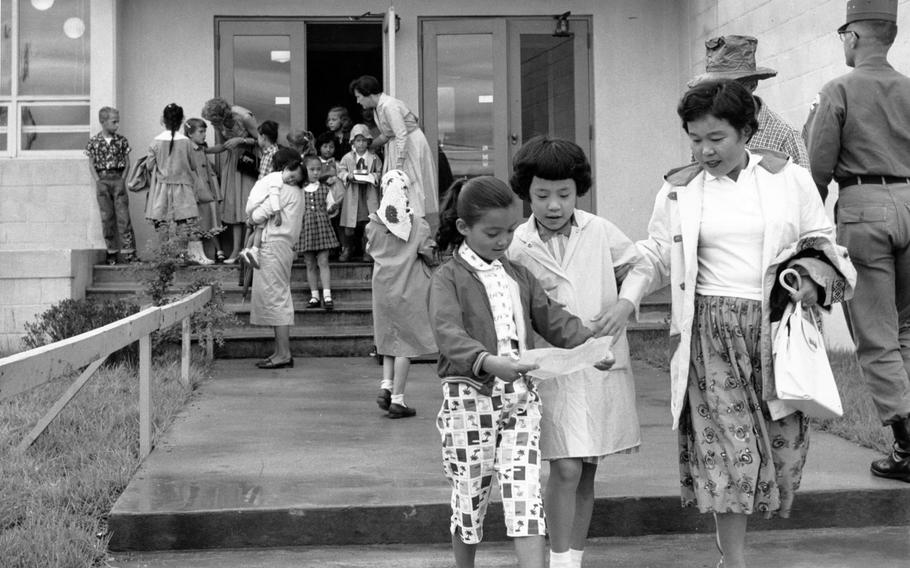 Children file out of grammar school on Aug. 29, 1960, as the first day of school comes to an end at Seoul American School.