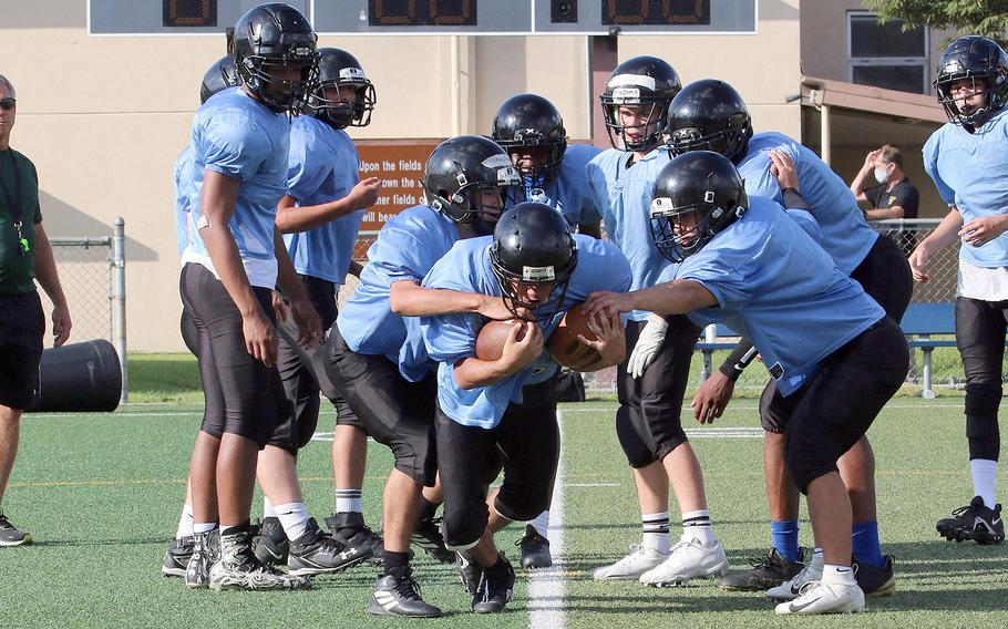 Running back Troy Abinsay is one of 26 players out for Osan football, the most since Jerome Learman took over as coach. But 15 are freshman and more than half have never played football before.