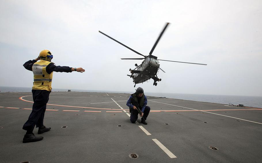 A Royal Navy Sea King helicopter takes off from HMS Albion during Exercise Auriga on July 14, 2010, near Camp Lejeune, N.C. This summer, divers found what they thought might be the Holy Grail of lost helicopters, a Navy Sea King famous for plucking Apollo astronauts from their capsules after moon-mission splashdowns.