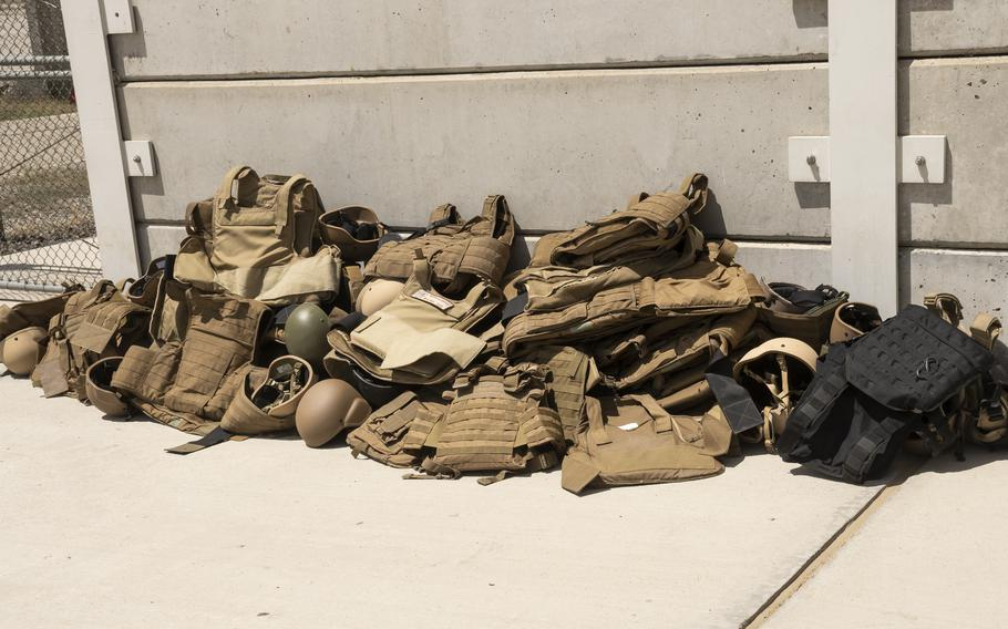 Body armor and helmets belonging to U.S. Embassy staff lay discarded at Kabul's military airport, as the staff evacuate Afghanistan on Aug. 15, 2021.