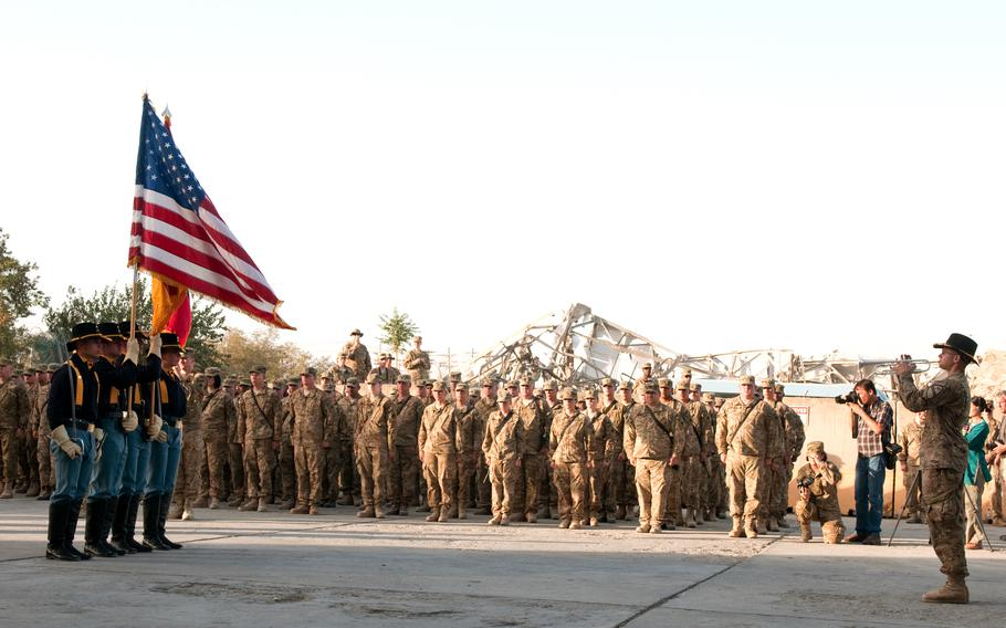 A 1st Cavalry Division bugler relays commands to the color guard during a ceremony in Bagram Airfield, Afghanistan, Sept. 11, 2011, remembering the attacks of 9/11.