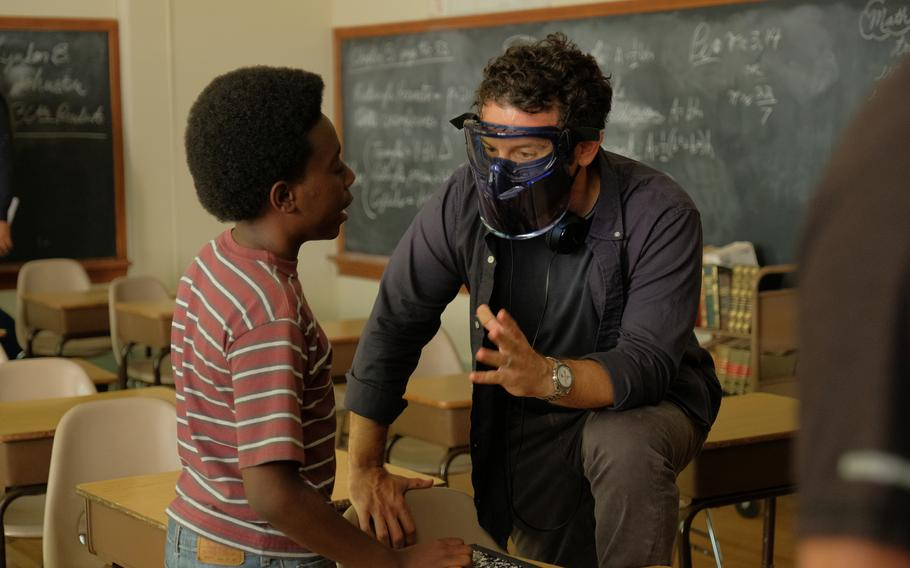 """Director Fred Savage, right, who starred in the original """"Wonder Years"""" cast, talks to actor Elisha Williams.."""