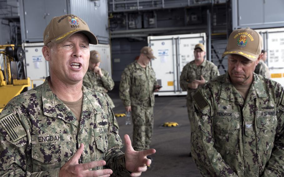 The commander of Expeditionary Strike Group 7, Rear Adm. Chris Engdahl, left, and the USS Miguel Keith's skipper, Capt. Troy Fendrick, speak to reporters from the ship's mission deck at White Beach Naval Facility, Okinawa, Oct. 6, 2021.