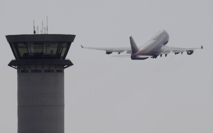 An aircraft takes off from Larnaca airport past the control tower, at the southern coastal city of Larnaca, Cyprus, Oct. 7, 2017. A flight safety organization is warning that a Turkish drone base in ethnically divided Cyprus could increase safety risks for thousands of commercial flights that cross the airspace around the eastern Mediterranean island.