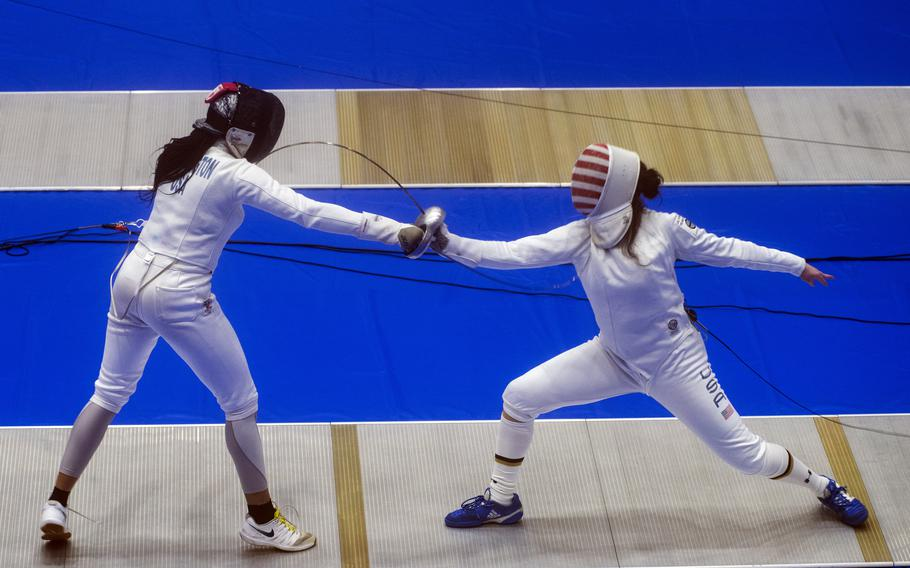 Amanda Pirkowski, a U.S. women's Olympic fencing team cadet athlete, spars with Olympian Isis Washington at Lotus Culture Center Arena, part of the Atago Sports Complex, in Iwakuni, Japan, July 14, 2021.