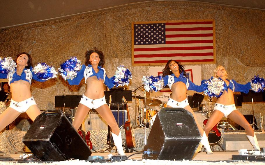 """Dallas Cowboys cheerleaders dance for service members during the sergeant major of the Army's 2007 """"Hope and Freedom"""" tour Dec. 23 at Bagram Airfield. Over the years, many performers visited the troops at Bagram, mostly with USO tours."""