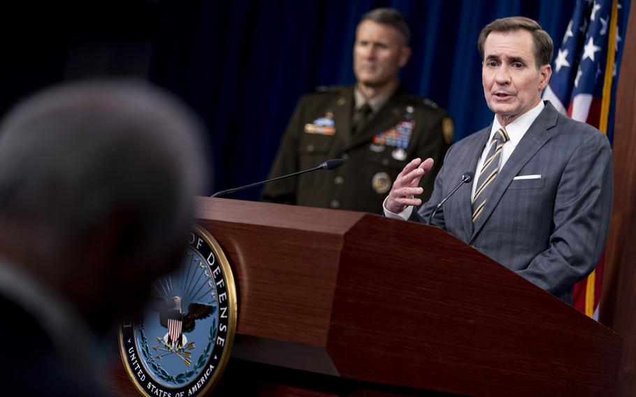 Pentagon spokesman John Kirby, accompanied by Army Major Gen. William Taylor, left, speaks during a news briefing at the Pentagon on Friday, Aug. 20, 2021.