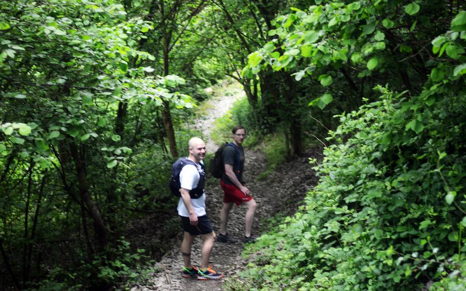 Joshua Seaman and Matthew McNeil, U.S. soldiers based in Germany, hike down part of the RheinBurgenWeg near Bad Salzig, Germany, June 5, 2021. The trail stretches 120 miles along the Rhine River but can be tackled in shorter stages.