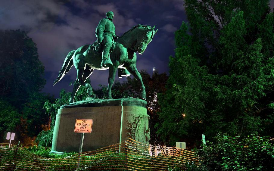This photo from 2018 shows a statue of Confederate Gen. Robert E. Lee in Charlottesville, Va., not far from where John Henry James was lynched by a mob in 1898. The statue was removed in July. MUST CREDIT: Washington Post photo by Michael S. Williamson.