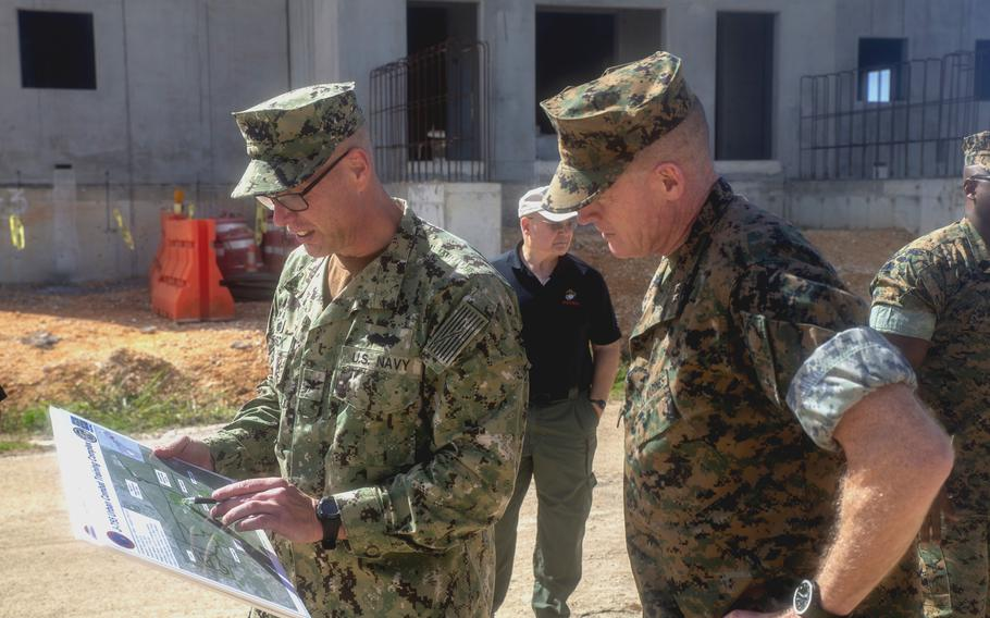 Navy Capt. Steve Stasick, left, officer In charge of construction at Marine Corps Marianas, briefs Maj. Gen. Edward Banta, commander of Marine Corps Installations Command, at Camp Blaz, Guam, on June 28, 2021.