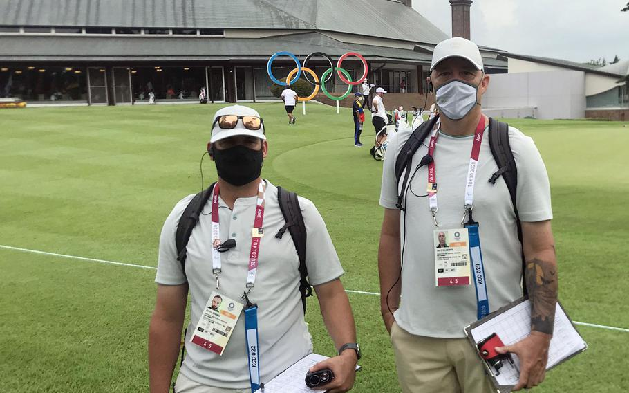 Tokyo Olympics volunteers Patrick Bowman, the golf professional at the Air Force-run Tama Hills Golf Course, and Jon Stillabower, operations manager at the Marine Corps' Taiyo Golf Course on Okinawa, pose at Kasumigaseki Country Club in Saitama prefecture, Japan, Thursday, July 29, 2021.