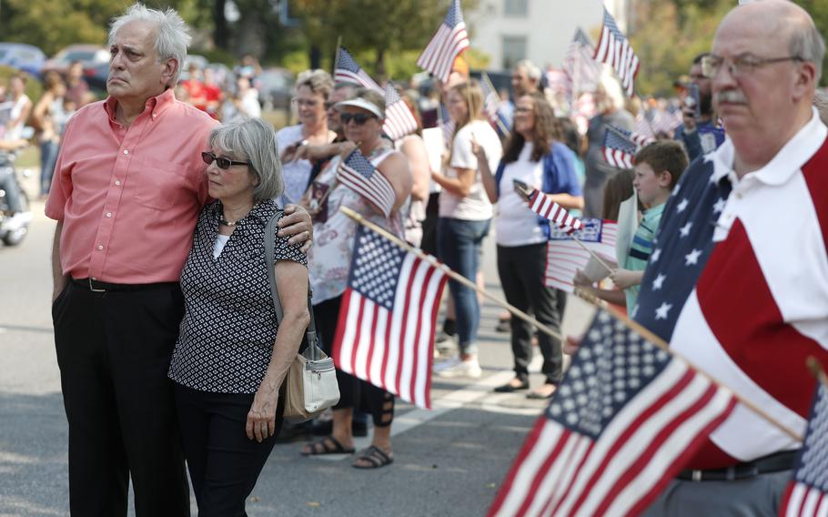 People watch the funeral procession pass by for Marine Corps Cpl. Humberto Sanchez on East Market Street on Sunday, Sept. 12, 2021, in Logansport, Ind.