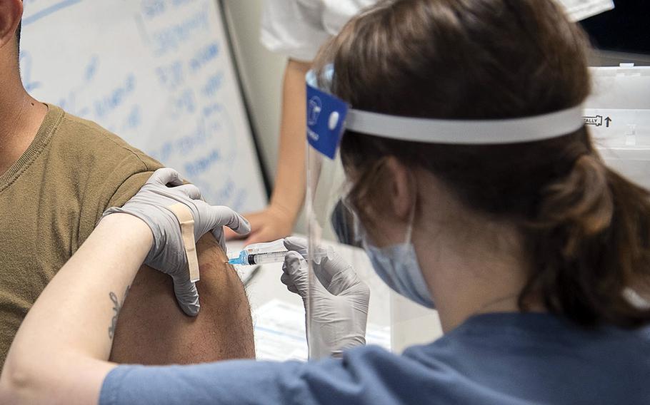 A sailor receives the Moderna COVID-19 vaccine earleir this spring at Naval Air Facility Atsugi, Japan.