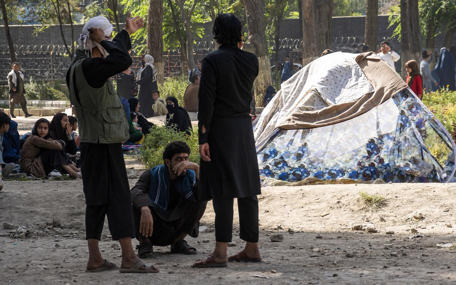 Displaced Afghans camp out at a Kabul park on Friday, Aug. 13, 2021, before the Taliban swept into the city. The Taliban's sweep through Afghanistan has spurred many veterans and others to seek ways to ease the humanitarian suffering in the country.