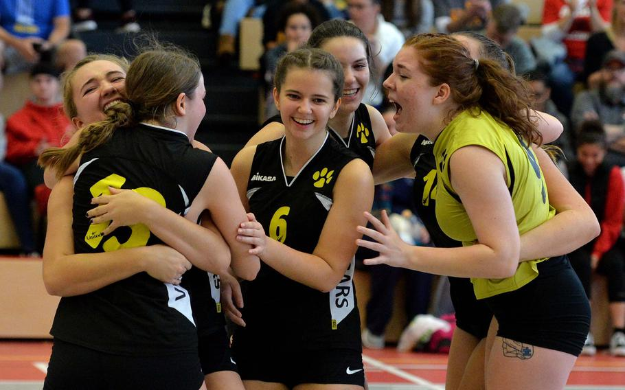 The Vicenza Cougars celebrate after defeating Naples  in the 2019 Division II finals at the DODEA-Europe volleyball championships in Kaiserslautern, Germany. After a 2020 season the was cancelled because of the coronavirus, teams throughout Europe will begin the 2021 competition this weekend.