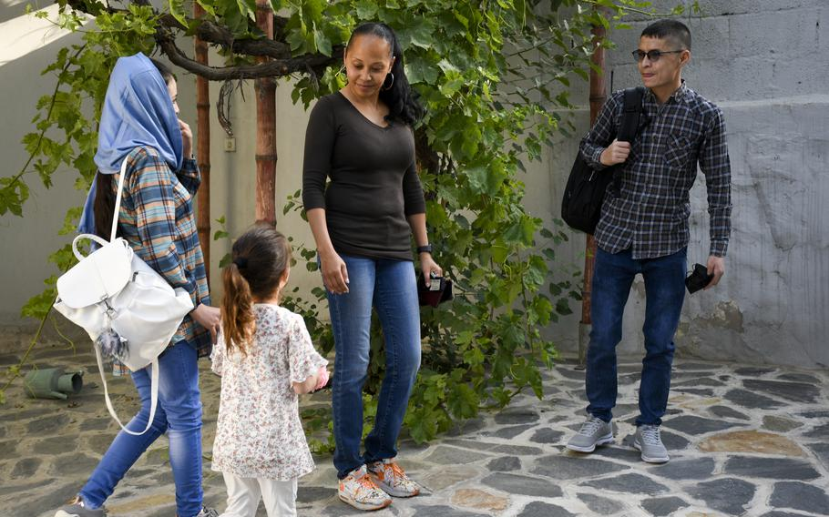 Mohammed Naiem Asadi, his wife Rahima, and their daughter, Zainab, meet with lawyer Kimberley Motley prior to leaving Kabul, Afghanistan, on June 1, 2021. Motley said the family received visas in early May to come to America after months of uncertainty.