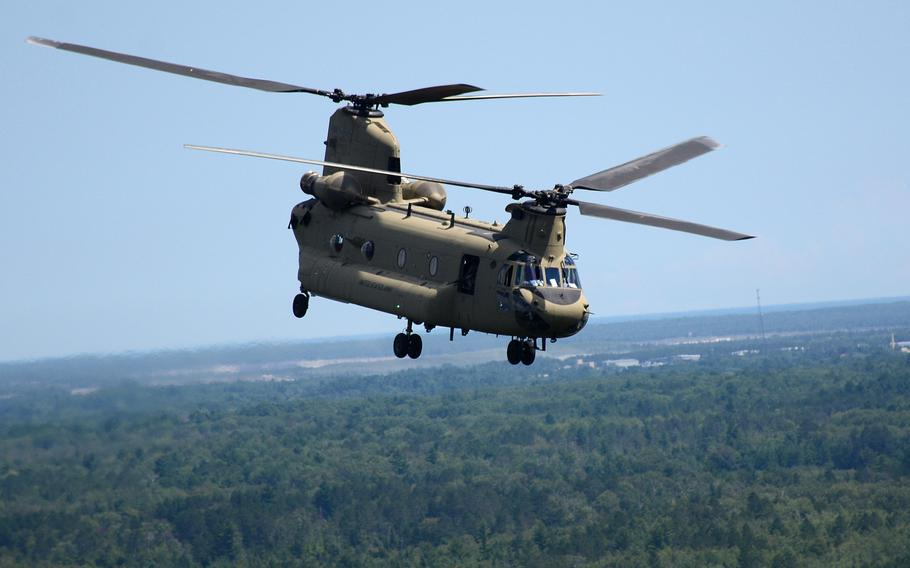 A CH-47 Chinook helicopter from 2nd General Support Aviation Battalion, 135th Aviation Regiment, Colorado Army National Guard, conducts a movement from the Combat Readiness Training Center in Alpena, Mich. to Camp Grayling Aug. 10, 2018, during Northern Strike 18.