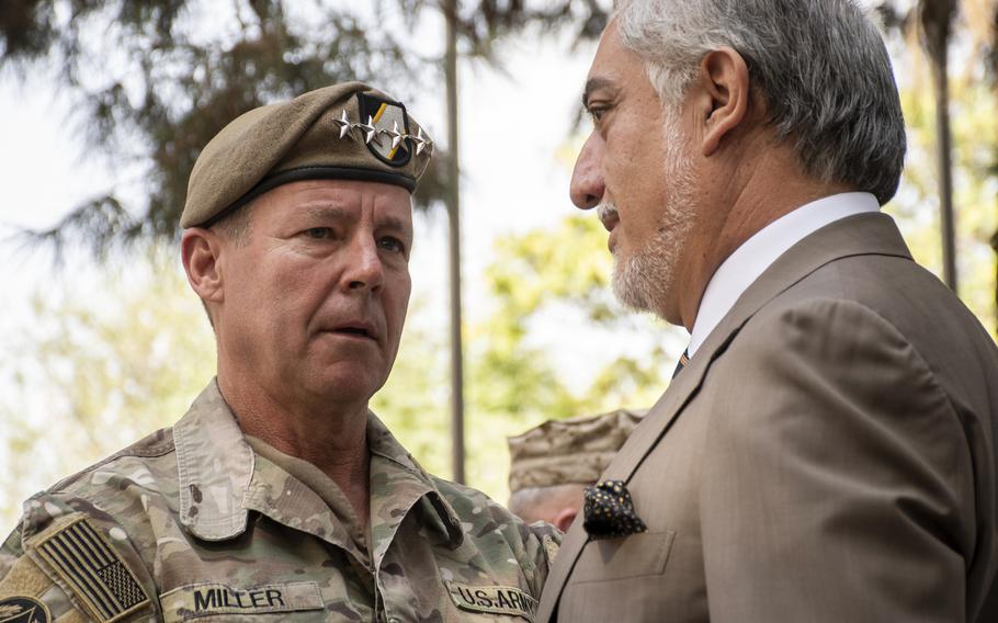 Gen. Scott Miller, left, speaks with Abdullah Abdullah, the head of the Afghanistans High Council for National Reconciliation, on July 12, 2021. The two were speaking at a ceremony at which Miller relinquished command of United States Forces-Afghanistan and NATOs Resolute Support mission.