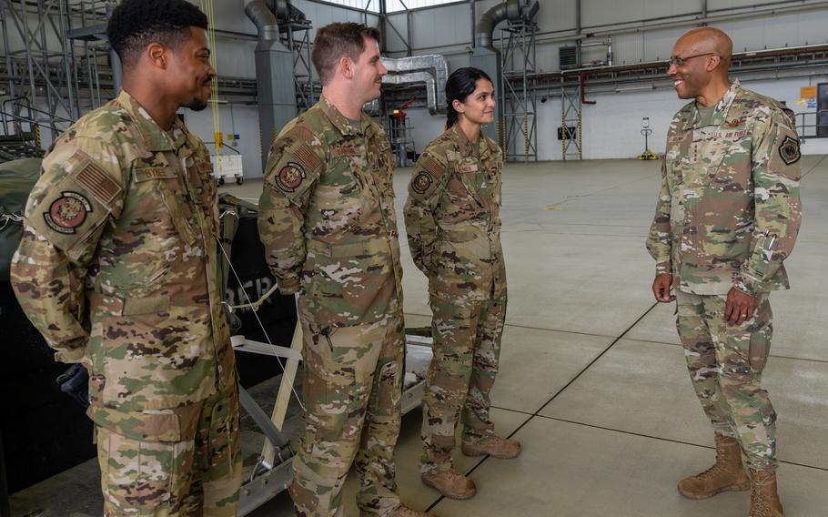 Air Force Chief of Staff Gen. Charles Q. Brown Jr., right, talks to 1st Lt. Miolani Grenier, Tech. Sgt. Eric Dafforn and Senior Airman Jordan Bybee during his visit to Ramstein Air Base, Germany, July 15, 2021.