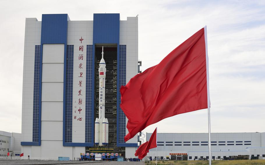 The Shenzhou-12 manned spaceship with its Long March-2F carrier rocket is being transferred to the launching area of Jiuquan Satellite Launch Center in northwestern China's Gansu province, on Wednesday, June 9, 2021.