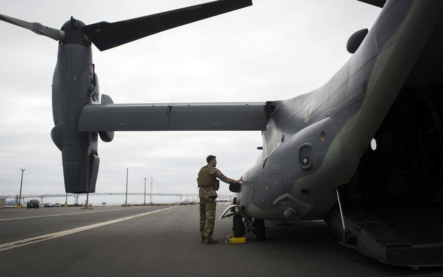 An airman inspects a CV-22 Osprey tiltrotor aircraft at Yokohama North Dock, Japan, April 5, 2018.