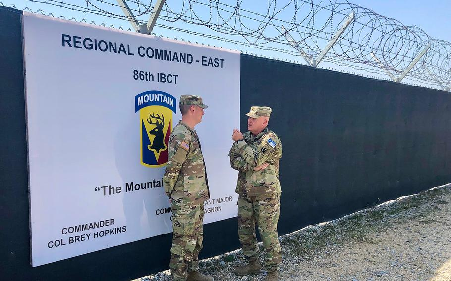 Col. Brey Hopkins, right, talks to Capt. Jeffrey Jace Rivard of the Vermont Army National Guard at Camp Bondsteel in Kosovo. The U.S.-led NATO force has helped keep the peace between rival Albanians and Serbs in Europes youngest nation since a brief war in 1999.