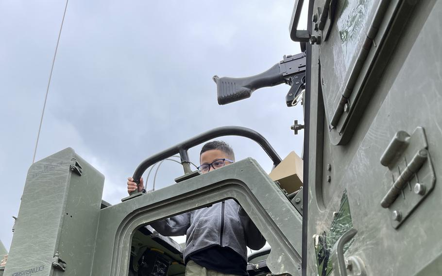 Rafael Salazar, 7, the son of Sgt. Monica Salazar, a soldier with the 41st Field Artillery Brigade, experiences an M270 Multiple Launch Rocket System at Grafenwoehr Training Area on Aug. 5, 2021. The 41st FAB hosted a family day during a live-fire training exercise.