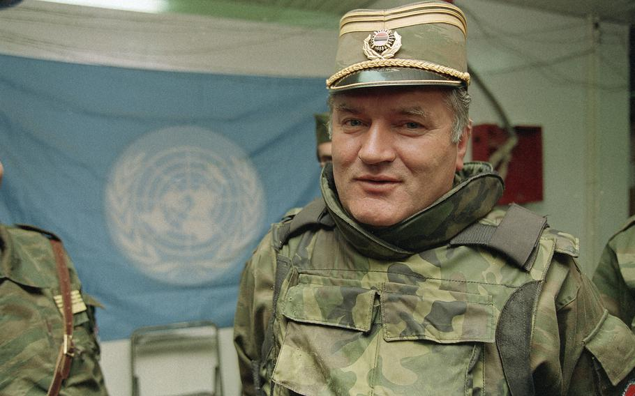 Bosnian Serb commander Gen. Ratko Mladic is pictured near a United Nations flag at Sarajevo Airport on May 17, 1993.