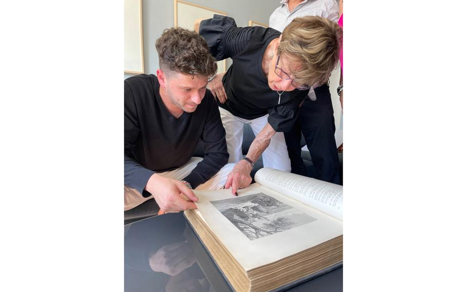Jacob Leiter and his grandmother Susi Kasper Leiter look through the Leiter family Bible from 1874 for the first time in New York City in June.