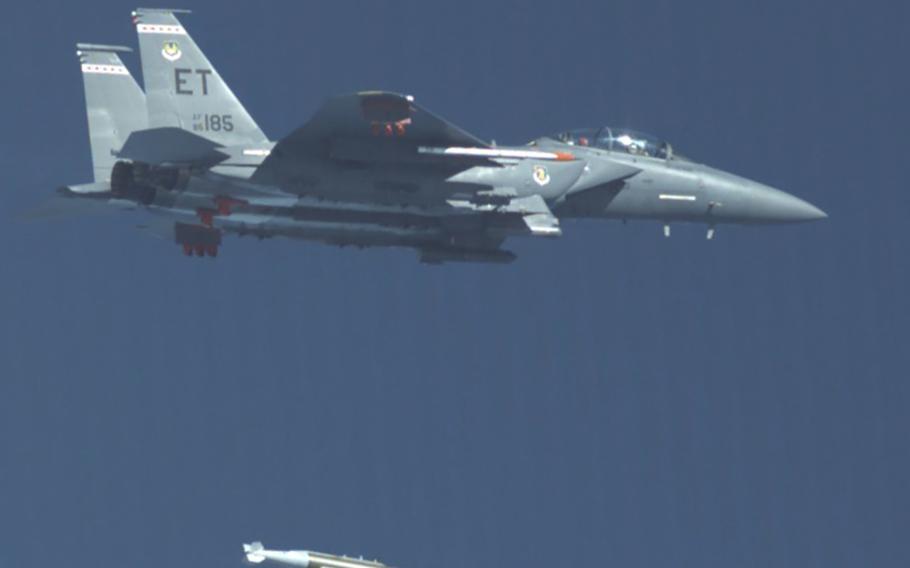 An F-15E Strike Eagle from the 40th Flight Test Squadron drops a GBU-72 Advanced 5K Penetrator bomb over the range at Eglin Air Force Base, Fla., Oct. 7, 2021.