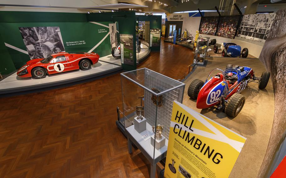In this image provided by the The Henry Ford, various types of racing cars, including the 1967 Ford Mark IV Race Car, left, are on display as part of the Driven To Win exhibit at the The Henry Ford Museum in Dearborn, Mich.