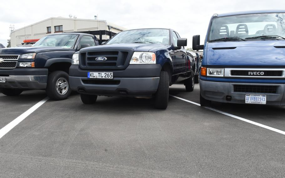 Government vehicles at Ramstein Air Base, Germany, on May 20, 2021, are parked in rows rather than in the diagonal parking places to make more room after the base lost funding for vehicle maintenance. Air Force bases were notified earlier this year that funding would be cut for the remainder of the fiscal year.