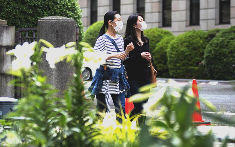 Women wear masks while out and about in Yokohama, Japan, May 24, 2021.