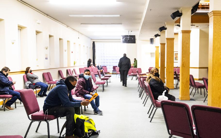 People sit in an observation area after receiving the Moderna coronavirus vaccine at an immunization event organized by the Association of Latino Professionals for America held at the Leon de Juda evangelical church in Boston on March 18, 2021.