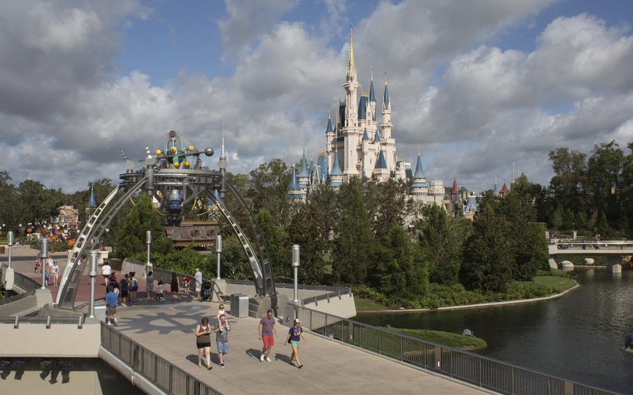 Visitors walk through the Walt Disney Co. Magic Kingdom park in Orlando on Sept. 12, 2017.