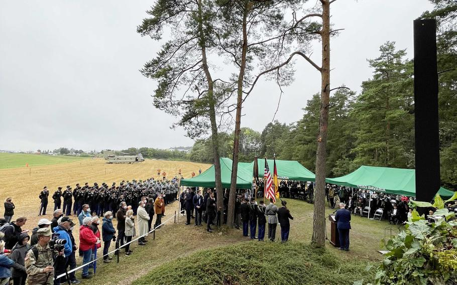 Attendees gather around the Pegnitz memorial site, Aug. 18, 2021, during the 50th anniversary ceremony for the helicopter crash that claimed the lives of 37 U.S. soldiers near Pegnitz, Germany.