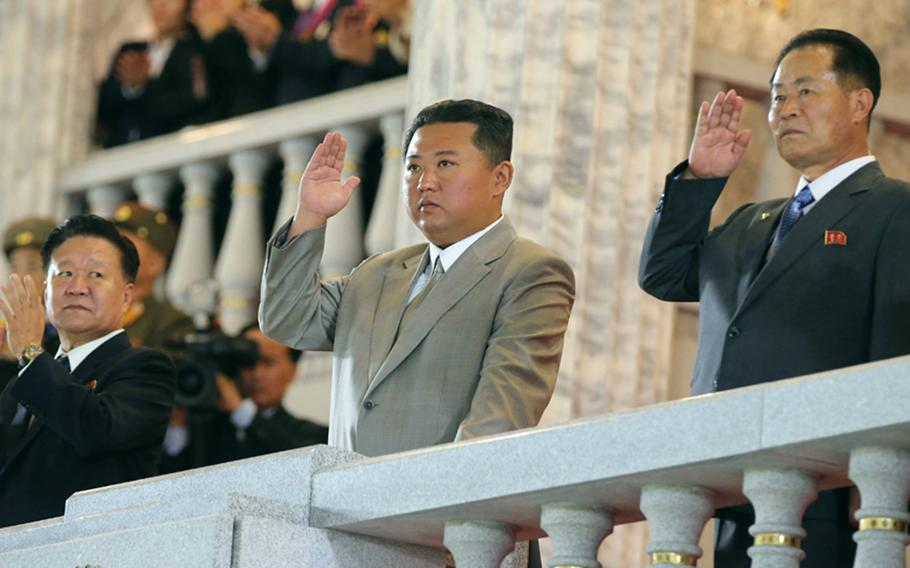 This image from the state-run Rodong Sinmun newspaper shows North Korean leader Kim Jong Un, center, attending a military parade in Pyongyang, early Thursday, Sept. 9, 2021.