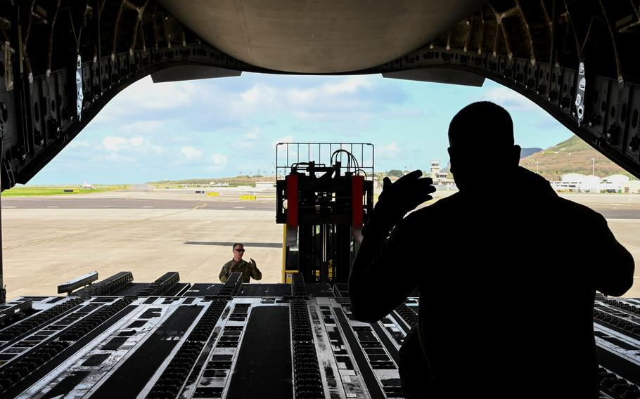 U.S. Air Force Tech. Sgt. James Delgadillo, 58th Airlift Squadron instructor loadmaster, directs a forklift at Marine Corps Base Hawaii, Sept. 9, 2021. More than 30,000 pounds of MQ-9 Reaper assets were loaded in support of exercise Agile Combat Employment Reaper.