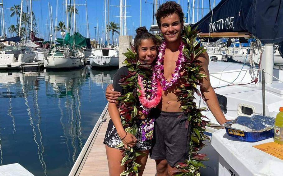 Tyler Savage and Bella Siegrist pose at Ala Wai Boat Harbor, Honolulu, June 5, 2021, just after completing a three-week sailboat trip from San Diego.