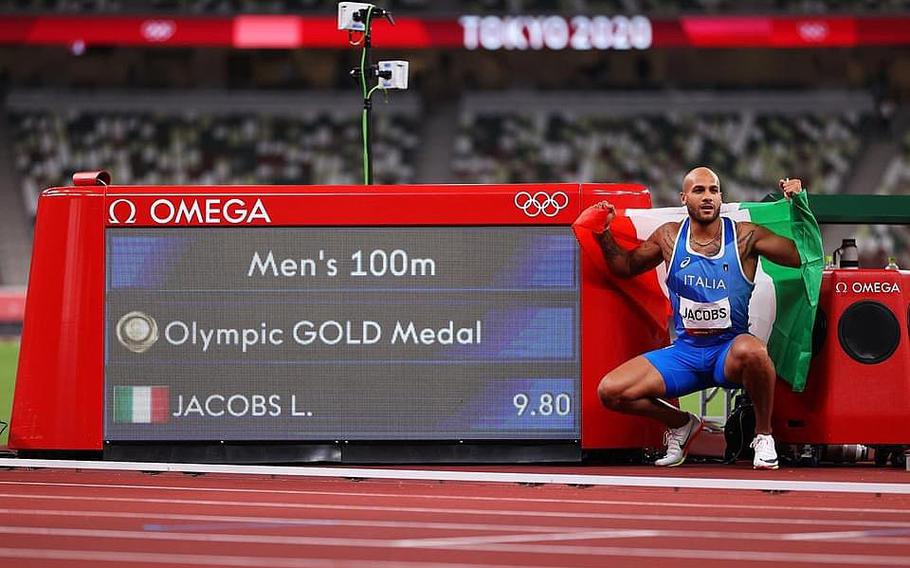 Lamont Marcell Jacobs strikes a pose after his victory in the 100 meters at the Olympics in Tokyo on Aug. 1, 2021.